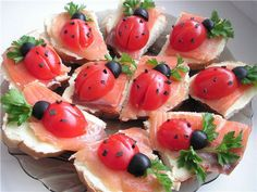 Lady Bug Appetizer  - Slice of bread  - Cream cheese (eg Philadelphia)  - Smoked Salmon  - Tomatoes  - Black olives  - Parsley decorating