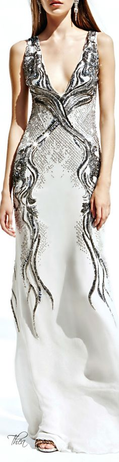 Gorgeous white gown with gunmetal detailing and embellishments. Love!