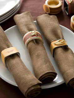 Decorate napkin rings for any occasion with fabric or craft paper and embellishments.