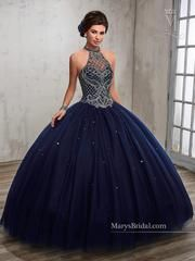 Make a grand entrance in this beaded illusion A-line Quinceanera ball gown by Mary's Bridal Princess Style Number 4Q503 at your Sweet 15/Sweet 16 party or at any formal event. Beautiful tulle quinceanera dress that features halter jewel neckline, beaded bodice, basque waistline, bead embellished skirt, lace-up closure, and matching bolero jacket. Colors: Dark Navy Blue, White Fabric: Tulle Mary's Bridal Princess Collection: Fall 2017 Please allow 4 - 5 months for delivery becau...