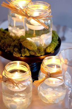 Mason jars Floating candles Centerpieces. I like this. It is simple, cute and the raffia makes it perfect for fall.