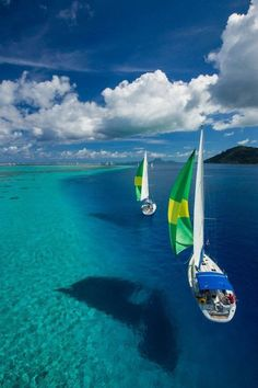 Bora Bora. Such a cool pic! looks a lot more shallow than it really is!!