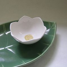 flower bowl and leaf server:    Using careful carving details, artist Whitney Smith brings these pottery pieces to life.