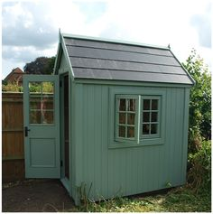 A potting shed with slate effect roof