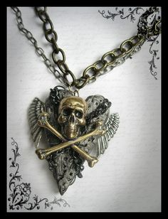 Steampunk Gothic Wing Silver Gunmetal Heart Chained Skull Crossbones Goth Jewelry Necklace. $27.00, via Etsy.