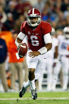 Blake Sims #6 of the Alabama Crimson Tide scrambles in the fourth quarter against the Auburn Tigers during the Iron Bowl at Bryant-Denny Stadium on November 29, 2014 in Tuscaloosa, Alabama.