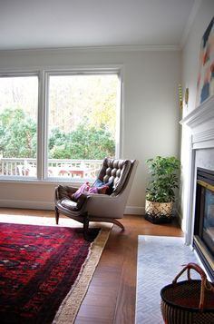 natural light and a beautiful chair inside the home of Suzy Lindow