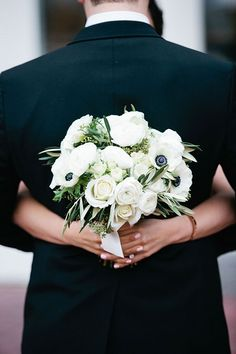 All-White Bouquet With Roses, Ranunculus, and Anemones | Brides.com