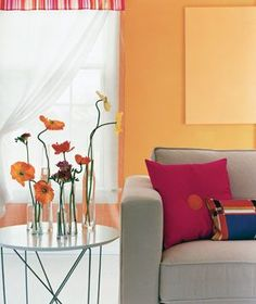 I like the orange and red contrasts in the room.  Not sure about the couch, though.  #orange #paint #rooms