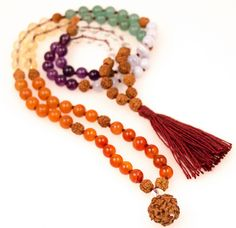 Seven Chakra Mala:  balancing the sacred inner staff of your being from crown, throat, third eye, heart, solar plexus, sacral, to rootMantra: I devote each day of the week to the exploration of each chakraGemstone: quartz crystal, amethyst, blue lace agate, green aventurine, citrine, red aventurine, carnelian, turquoise