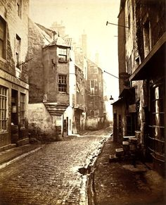Cardinal Beaton's House, Cowgate - Edinburgh - 1868  I really enjoy these old curved street pictures.