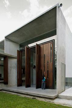emma house by lisa foo // timber folding door. Folding Doors, Modernism, Habitats, Facade, Modern Furniture, Entrance, Lisa, Exterior, Detail