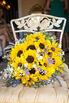 Sunflowers are a cheerful choice; add some lavender for contrast.                   Image Source: Town and ...
