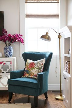 How to Create a Reading Nook. Really nice for living room or library. LOVE the pillow here, too.
