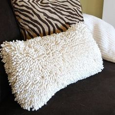 If you have basic sewing skills, it's easy to turn cheap bath mats or accent rugs into cuddly throw pillow covers. | 17 Ways To Make Your Bed The Coziest Place On Earth