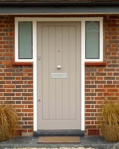 This modern wood front door has a contemporary hand-painted finish, opaque sidelights and chrome door furniture. A great choice for many home styles. Wood Front Doors, House Front, Contemporary Front Doors, House Styles, Modern, Front Door, Modern Wood, Home Styles, Doors