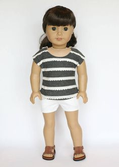 Striped tee and shorts outfit by EverydayDollwear on Etsy. Made following a modified version of the T-Shirt Variations and the Cut Off Shorts pattern. Get them here https://www.pixiefaire.com/products/t-shirt-variations-18-doll-clothes. https://www.pixiefaire.com/products/cut-off-shorts-18-doll-clothes. #pixiefaire #tshirtvariations #cutoffshorts