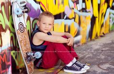 Little boy with skateboard photography. Love the urban modern graffiti wall setting.