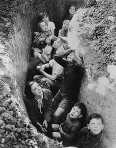 Children in an English bomb shelter during the German bombing of British cities in 1940-41.