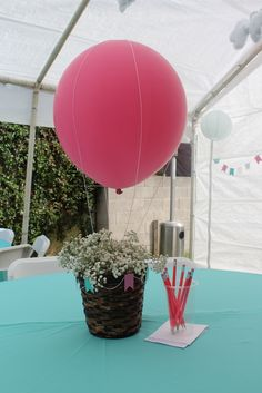 Hot air balloon table decoration at a baby shower #hotairballoon #decoration