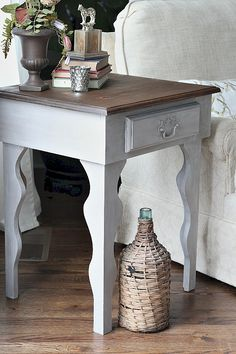 Curvy side table makeover - top is stained Dark Walnut and then waxed with Maison Blanche Dark Wax, the body is painted with Maison Blanche Vintage Furniture Paint in Pecan and then waxed with M.B. Chalk White Lime Wax to makes a weathered gray