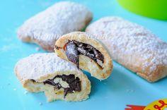 Biscotti ripieni al cioccolato, ricetta veloce, buoni a colazione nel latte o a merenda, biscotti facili per bambini con pasta frolla al burro, snack dolce