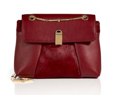 Roland Mouret, Leather/Haircalf Bagatelle Shoulder Bag, €1543. http://yourlivingcity.com/luxembourg/style-in-the-city/shopping/12-gifts-for-xmas-for-the-woman-in-your-life-that-has-everything/