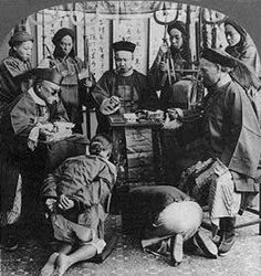 """Trials of Boxer Prisoners Conducted by Chinese Government. The alleged Boxers in this photograph are on trial before a Chinese court. If they were convicted (as most of those on trial were), it may well have been the foreigners who actually executed them. Genl Adna Chaffee said, """"It is safe to say that where one real Boxer has been killed... fifty harmless coolies or laborers on the farms, including not a few women and children, have been slain."""""""