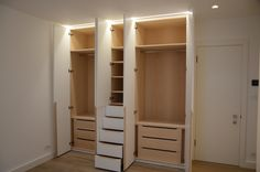A large fitted wardrobe with hanging rails, shelving and drawers. We used lime oak veneer carcases and spray painted the external. There are recessed grooves for the door and drawer handles. The doors are hung on 110° sprung concealed hinges and the drawers are on under mounted runners. #masterbedroom #bedroomwardrobes #recessedgroovehandles #recesshandles #concealedhinges #limeoak #limeoakveneer #LEDlighting #wardrobelights #bedroomstorage #cupboards #fittedcupboards #fittedwardrobe