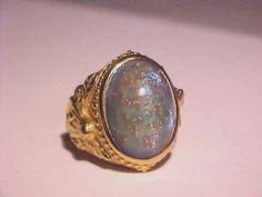 Goldtone KIRKS FOLLY Ring w/ Angel Molded Sides & Gold Flecks Blue Stone Center
