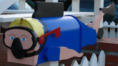 Diver Mailbox. Creative colorful diver mailbox. (via Craig Stephen)