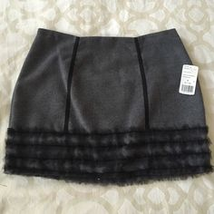 Grey and black F21 skirt- NWT Grey wool fabric with black grosgrain and tulle trim detailing. Zipper up the back closure. Never worn and in perfect condition Forever 21 Skirts Mini