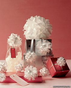 Like Champagne bubbles, these bows seem light as air atop a beautifully wrapped gift. The best part is, they're simple to make; all you need are scissors and two store-bought bows. --Martha Stewart