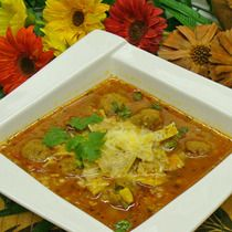 This authentic Mexican recipe is very popular. Once you taste it, it is sure to become one of your favorites. Ground beef and sausage  'albondigas' meatballs are simmered in a tomato and chile beef broth base. Rice and corn add starch for a hearty meal in a dish. Serve soup topped with crushed