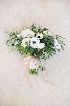 Anemone Bouquet on SMP: http://www.StyleMePretty.com/southwest-weddings/2014/03/17/traditional-las-vegas-wedding/ J. Anne Photography