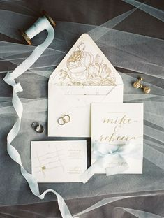 simple floral white and gold wedding invitation