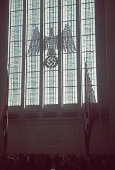 A massive German cathedral window embossed with the national emblem.