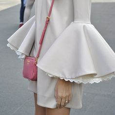 Fluted sleeves and a sweet Prada purse.