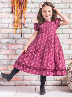 A plum and burgandy toned floral takes root and blooms beautifully on this classic style made of light cotton. Lined with crinoline beneath the bottom tier of the skirt for an unforgettably timeless design. Toddler Dress, Toddler Outfits, Kids Outfits, Girls Boutique Dresses, Baby Girl Dresses, Toddler Fashion, Kids Fashion, Kids Frocks Design, Frocks For Girls