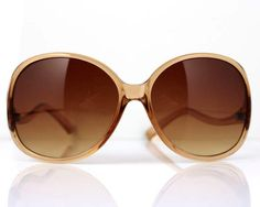 Vintage sunglasses. Made in West Germany.  Light brown frame. Measurements: hinge to hinge 130 mm (5.12) front of frame 155 mm (6.10) lens 60 mm x 51 mm (2.36 x 2.01) temple length 120 mm (4.72)  The sunglasses are in very good vintage condition and contain only minor signs of wear and age.  ******************************************************************************  Please do not hesitate to contact for any further details.  Also please check the shop policies. This will help to avoid…