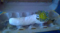 mummified body made from blu tac and masking tape