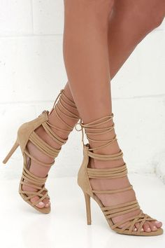 """With our help and the Steps to Success Camel Suede Lace-Up Heels at the ready, all of your OOTDs will be winners! Soft vegan suede straps cross and climb through a cage-y upper, while long laces (with gold aglets) tie around the leg. 3"""" zipper at the heel."""