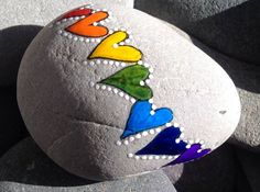 ~Keeping it simple, rainbow hearts    Painted rock (sea stone) from Cape cod    A beautiful stone, worn smooth over time being tumbled in the sea~