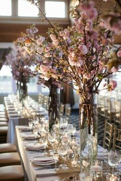 Cherry blossoms in tall cylinders. Bridal Expo Chicago Wedding decor.  Centerpieces.