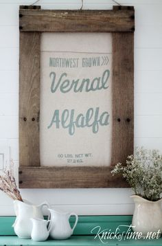 How to make a rustic pallet wood frame for a vintage grain sack or seed bag.