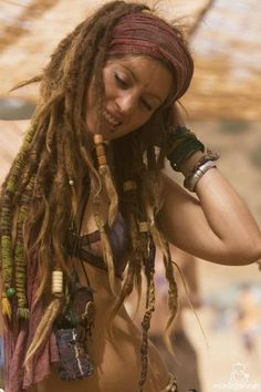 i adore dreads, but not a permanent thing  for me:) i did have clip in dreads that  helped me when the playa dust settled on my hair.. :)