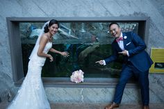 Wedding guests are welcome to enjoy our wildlife exhibits! Melissa and Dorian (human couple) with Gunner and Belle (otter couple).