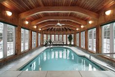 Large indoor pool with all-wood ceiling including large exposed wood beams