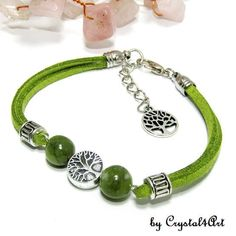 """Leather bracelet with jade and tree of life""""Jade & tree"""" Wear or offer as a gift, this suede leather bracelet from symbol category jewerly, decorated with silvery tree of life and olive green jade spheres. Jade Tree, Tree Of Life, Suede Leather, Olive Green, Jewerly, Bracelets, Handmade, Gifts, Jewlery"""