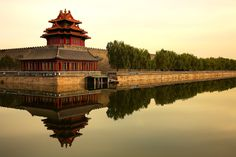Chinese Architecture / The Forbidden City. Beijing, China. It was built between 1406 and 1420 during the Ming Dynasty. It had been the imperial home of 24 emperors of the Ming (1368-1644) and Qing (1644-1911) dynasties. From their throne in the Forbidden City, they governed the country by holding court sessions with their ministers, issuing imperial edicts and initiating military expeditions.